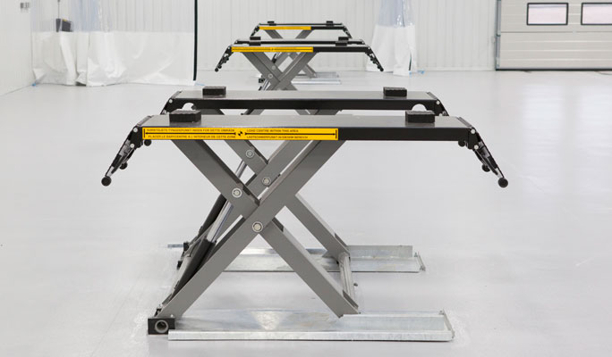 Bodyshop equipment vehicle lifts
